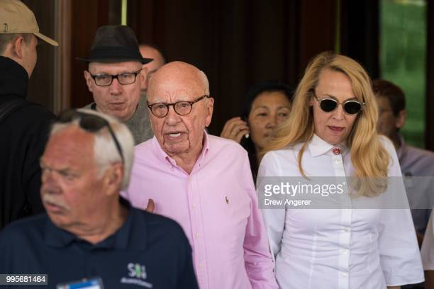 Robert Thomson chief executive of News Corp Rupert Murdoch chairman of News Corp and cochairman of 21st Century Fox and Jerry Hall arrive at the Sun...