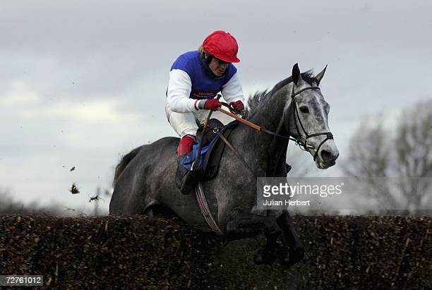 Robert Thornton and Ferimon clear the last fence to land The World Bet Exchange Now Live at wbxcom Handicap Chase Race run at Huntingdon Racecourse...
