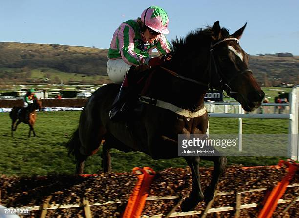 Robert Thornton and Katchit clear the last hurdle to win The boylepokercom Juvenile Novices Hurdle Race run at Cheltenham Racecourse on December 9 in...
