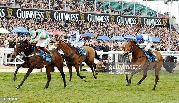Robert Thornton and Katchit kick clear on the run in to win The Smurfit Kappa Champion Hurdle at Cheltenham Racecourse on March 11 2008 in Cheltenham...