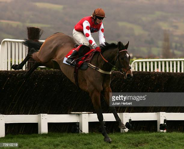 Robert Thornton and My Way de Solzen clear the last fence before landing The Aquanti Group 'Dipper' Novices Steeple Chase Race run at Cheltenham...