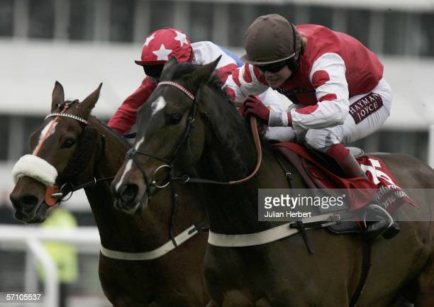 Robert Thornton and My Way de Solzen get the better of the Johny Murtagh ridden Golden Cross to land The Ladbrokes World Hurdle Race on the third day...