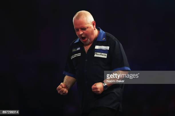 Robert Thornton of Scotland celebrates after winning the first set during the second round match against Mensur Suljovic of Austria on day nine of...
