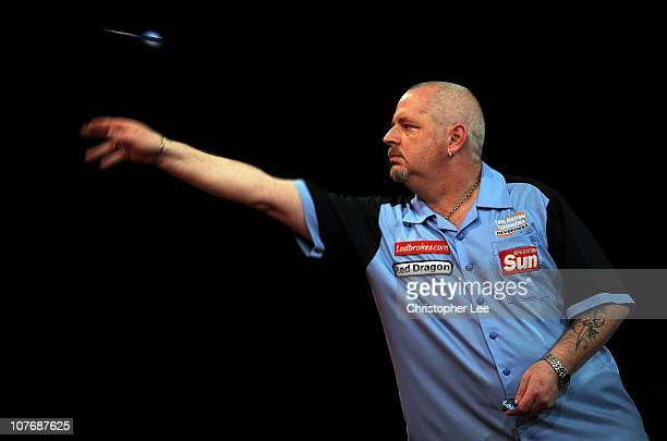 Robert Thornton of Scotland in action during his 2011 Ladbrokescom World Darts Championship First Round match against Nigel Heydon of England at...