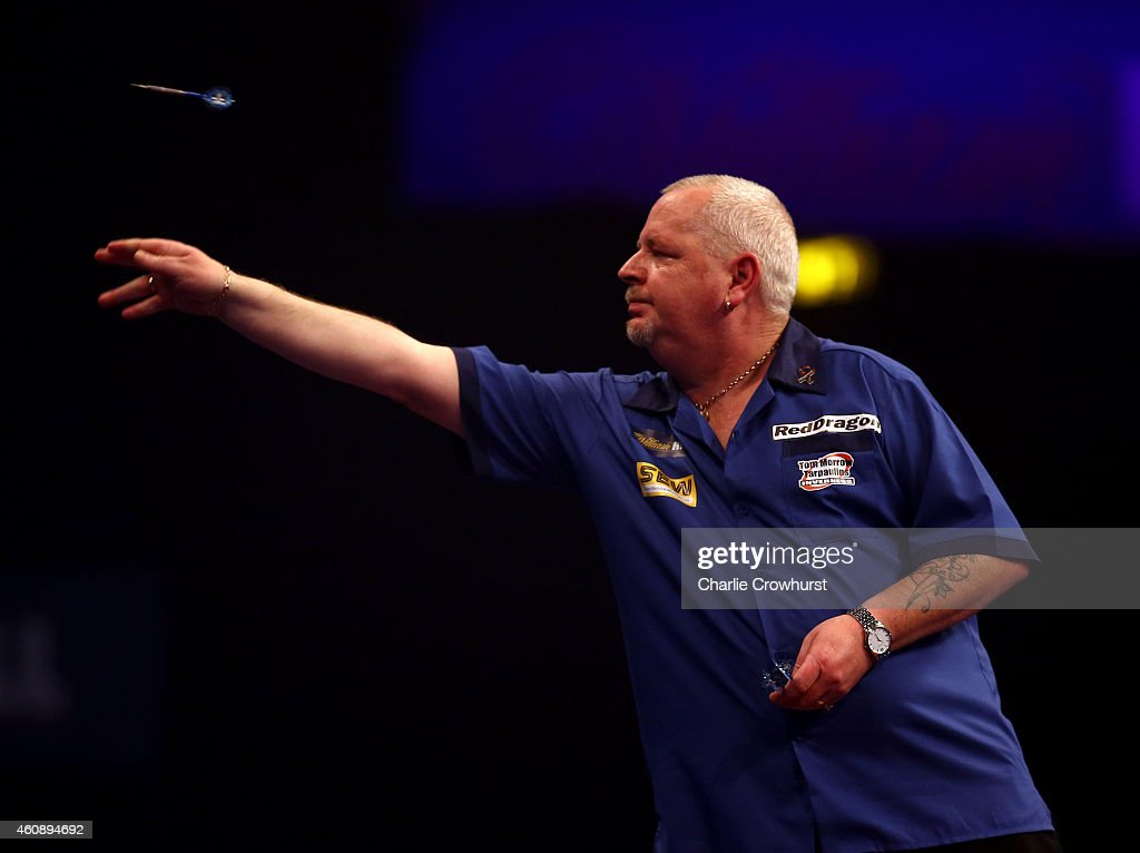 Robert Thornton of Scotland in action during his third round match against Benito van de Pas of Holland during the William Hill PDC World Darts Championships on Day Nine at Alexandra Palace on December 29, 2014 in London, England.