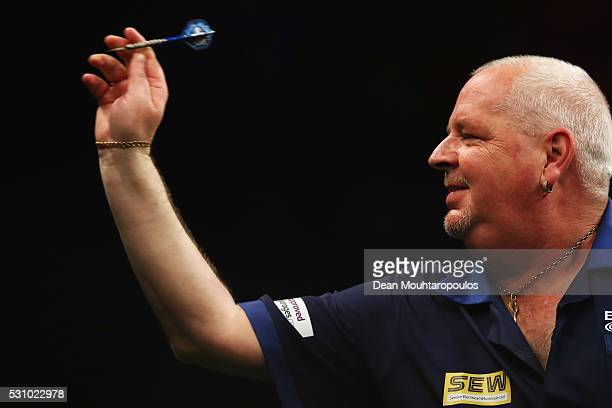 Robert Thornton of Scotland plays a shot in his match against James Wade of England during the Darts Betway Premier League Night 15 at Rotterdam Ahoy...