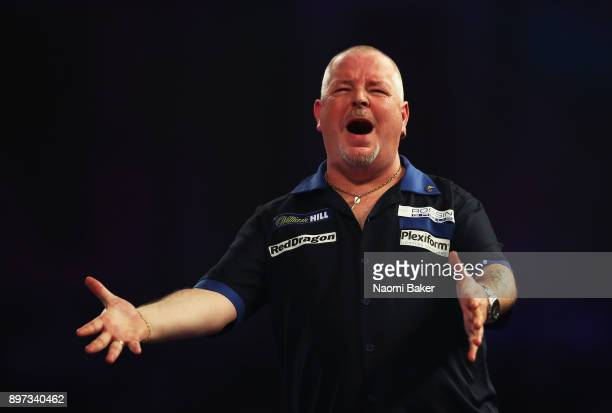 Robert Thornton of Scotland reacts during the second round match against Mensur Suljovic of Austria on day nine of the 2018 William Hill PDC World...