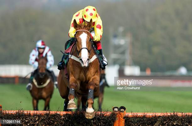 Robert Thornton riding Araldur clear the last to win The Free Bets At ggcom Novices' Hurdle Race to record his 1000th winner of his riding career at...