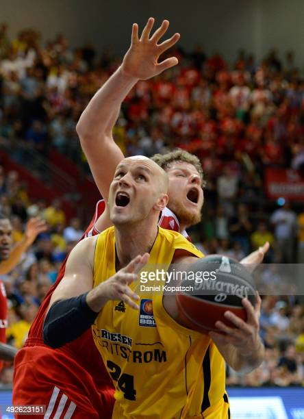 Robert Tomaszek of Ludwigsburg is challenged by John Bryant of Muenchen during the Beko BBL Playoffs semifinal match between MHP RIESEN Ludwigsburg...