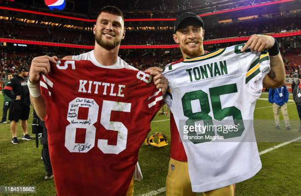 Robert Tonyan of the Green Bay Packers and George Kittle of the San Francisco 49ers exchange jerseys after the game at Levi's Stadium on November 24,...
