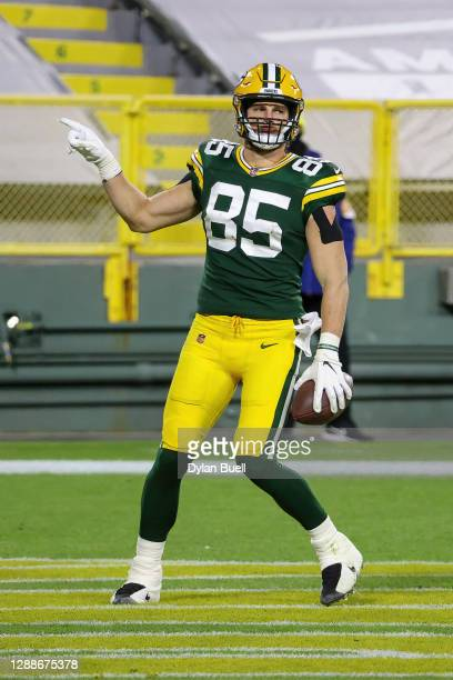 Robert Tonyan of the Green Bay Packers celebrates after scoring a touchdown in the third quarter against the Chicago Bears at Lambeau Field on...