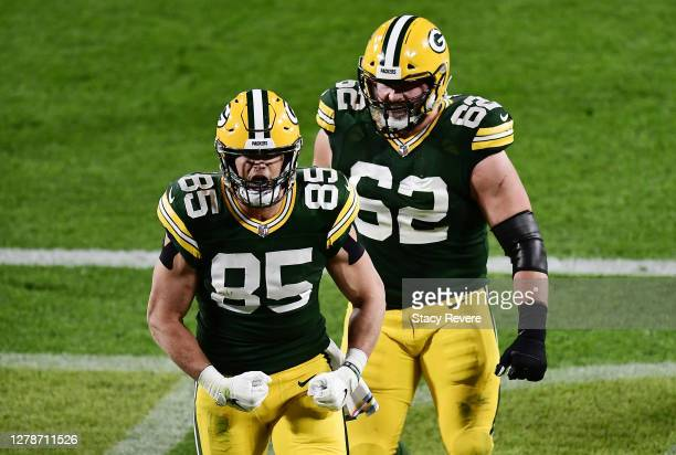 Robert Tonyan of the Green Bay Packers celebrates with Lucas Patrick after scoring a touchdown during the second quarter against the Atlanta Falcons...