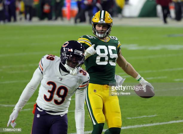 Robert Tonyan of the Green Bay Packers reacts toward Eddie Jackson of the Chicago Bears after catching a pass for a touchdown during the 2nd half of...