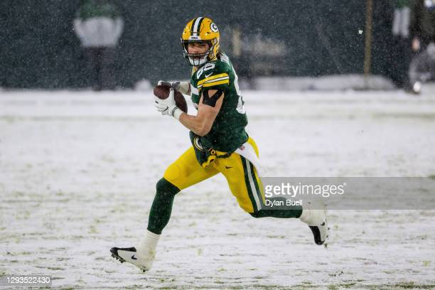Robert Tonyan of the Green Bay Packers runs with the ball in the first quarter against the Tennessee Titans at Lambeau Field on December 27, 2020 in...