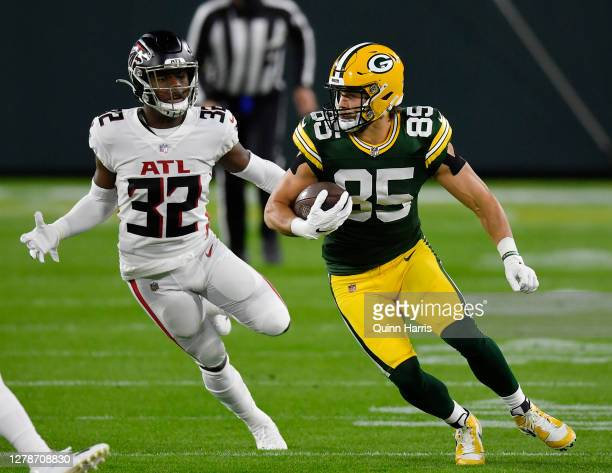 Robert Tonyan of the Green Bay Packers runs with the football against Jaylinn Hawkins of the Atlanta Falcons in the first half at Lambeau Field on...