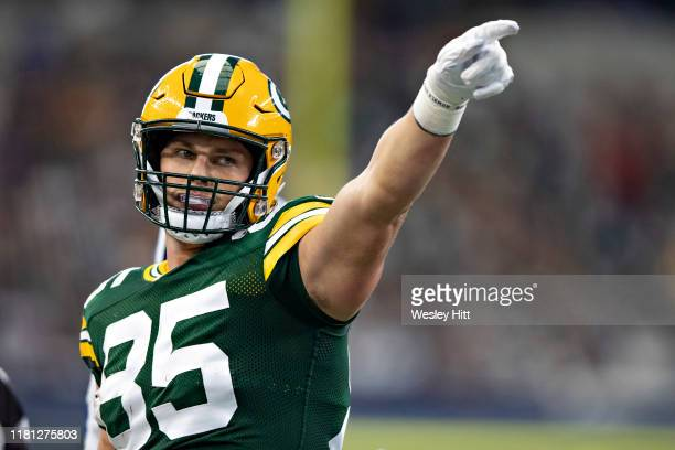Robert Tonyan of the Green Bay Packers signals first down after making a catch during a game against the Dallas Cowboys at AT&T Stadium on October 6,...