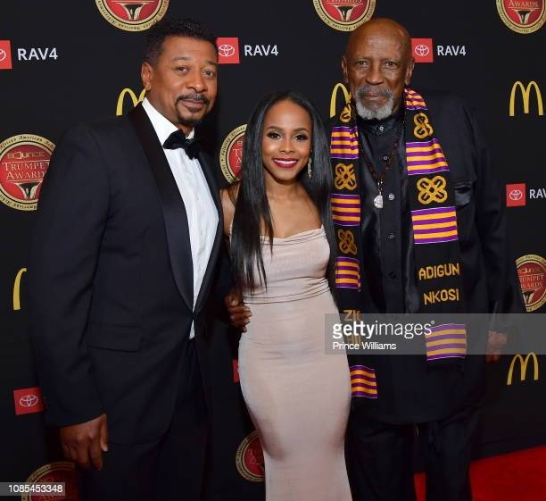 Robert Townsend Marquita Goings and Louis Gossett Jr attend 2019 Trumpet awards at Cobb Energy Performing Arts Center on January 19 2019 in Atlanta...