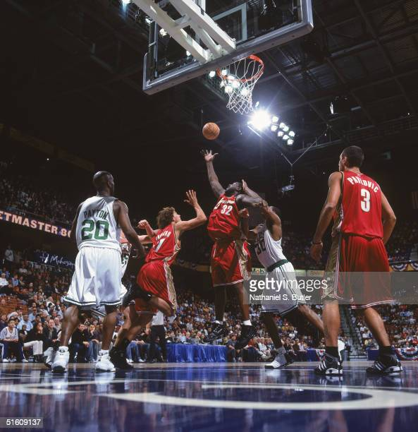 Robert Traylor of the Cleveland Cavaliers goes for the rebound under pressure from Mark Blount of the Boston Celtics during the game at the Mohegan...