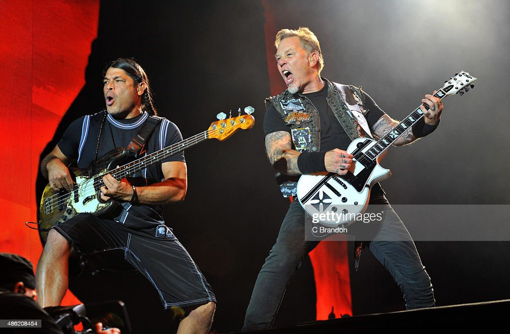Robert Trujillo and James Hetfield of Metallica headline on the Main Stage during the 2nd Day of the Reading Festival at Richfield Avenue on August 29, 2015 in Reading, England.