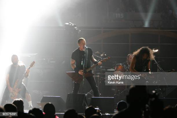 Robert Trujillo James Hetfield and Kirk Hammett of Metallica perform onstage at the 25th Anniversary Rock Roll Hall of Fame Concert at Madison Square...