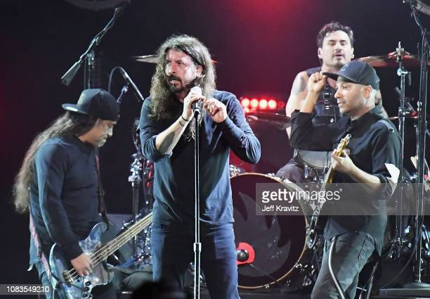 Robert Trujillo of Metallica, Dave Grohl of Foo Fighters, Brad Wilk of Audioslave, and Tom Morello of Audioslave perform onstage during I Am the...