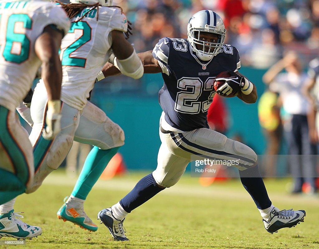 Robert Turbin #23 of the Dallas Cowboys in action during the second half of the game against the Miami Dolphins at Sun Life Stadium on November 22, 2015 in Miami Gardens, Florida.
