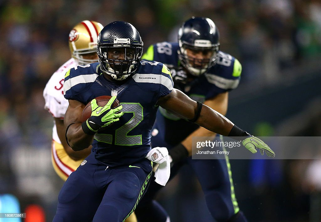 Robert Turbin #22 of the Seattle Seahawks runs the ball against the San Francisco 49ers on September 15, 2013 at CenturyLink Field in Seattle, Washington.