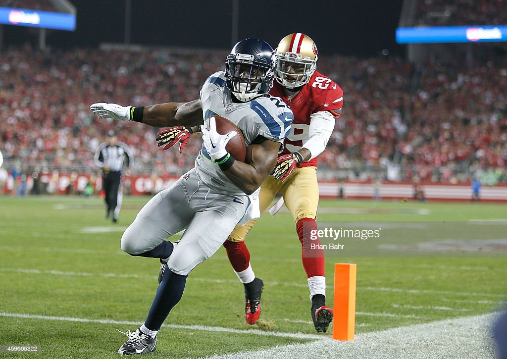 Robert Turbin #22 of the Seattle Seahawks scores the first touchdown against Chris Culliver #29 of the San Francisco 49ers in the first half at Levi's Stadium on November 27, 2014 in Santa Clara, California.