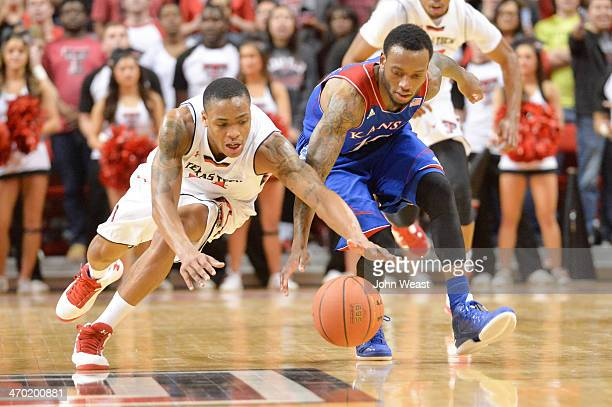 Robert Turner of the Texas Tech Red Raiders fights for a loose ball during game action against the Kansas Jayhawkson February 18 2014 at United...