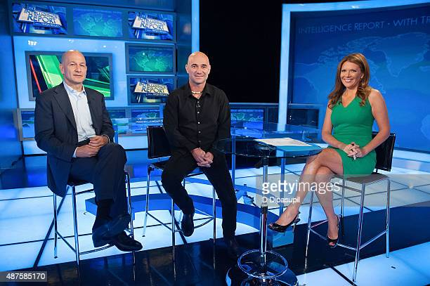 K Robert Turner Trish Regan and Andre Agassi pose on the set of FOX Business Network at FOX Studios on September 10 2015 in New York City