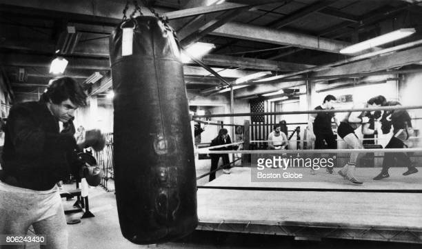 Robert Urich and Gerry Cooney work out during a filmed segment of the television show Spenser For Hire on Jan 30 1986