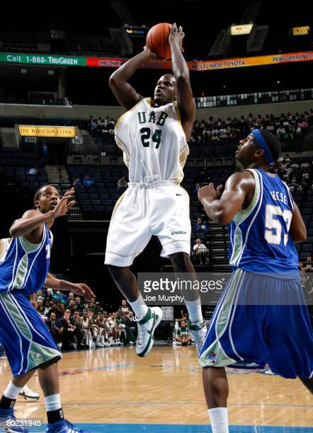 Robert Vaden of the UAB Blazers shoots a jumpshot past Ray Reese of the Tulsa Golden Hurricane during the quarterfinals of the Conference USA...