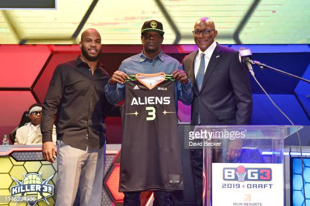 Robert Vaden poses with Aliens player Andre Owens and BIG3 Commissioner Clyde Drexler after being drafted at by the Aliens in the third round during...