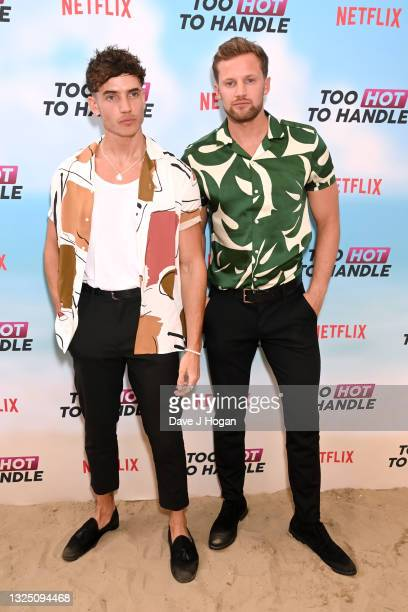 """Robert Van Tromp and Cam Holmes attends the """"Too Hot To Handle"""" Season 2 Special Screening photocall at Fulham Beach Bar on June 23, 2021 in London,..."""
