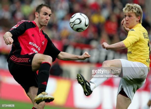 Robert Vittek of Nuremberg challenge for the ball with Axel Bellinghausen of Kaiserslautern during the Bundesliga match between 1.FC Nuremberg and...