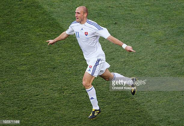Robert Vittek of Slovakia celebrates scoring the opening goal during the 2010 FIFA World Cup South Africa Group F match between Slovakia and Italy at...