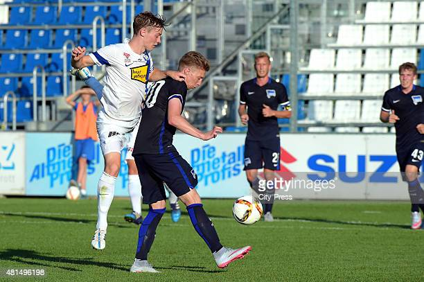 Robert Voelkl of SV Groedig and Mitchell Weiser of Hertha BSC during the game between SV Groedig and Hertha BSC on july 21 2015 in Schladming Austria