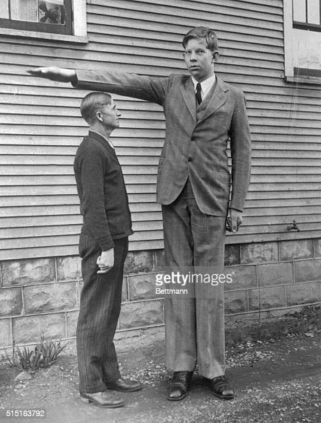 Robert Wadlow Alton Illinois giant is shown at age 13 with his father Harold Wadlow Father is five feet eleven inches tall Son stands seven feet four...