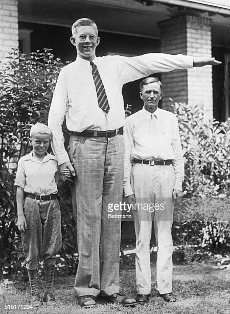 Robert Wadlow Alton Illinois giant was 7 feet 4 inches tall and weighed 290 pounds at the age of 13 He is shown here with his father Harold Wadlow...