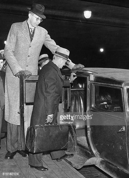 Robert Wadlow of Alton IL and his father Harold Wadlow shown in their arrival in Chicago to visit the National Shoe Fair where the boy looked over...