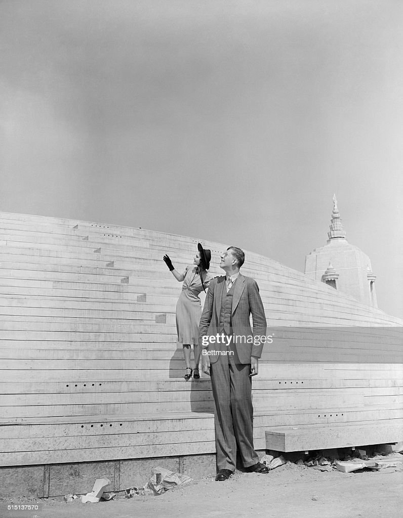 Robert Wadlow Standing with a Model : News Photo
