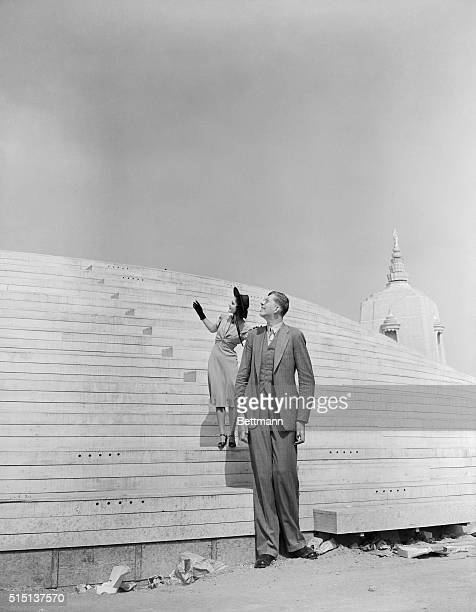 Robert Wadlow of Alton Illinois is shown with an exposition model He is over eight feet tall and wears size 37 shoes