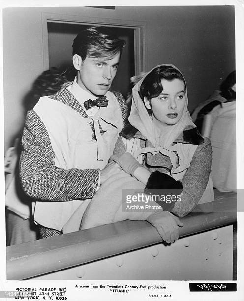 Robert Wagner and Audrey Dalton wearing life preservers in a scene from the film 'Titanic' 1953