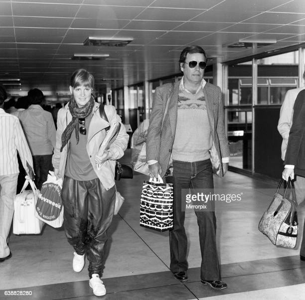 Robert Wagner and his 18yearold daughter Katie at London Airport to fly to Los Angeles 30th April 1982