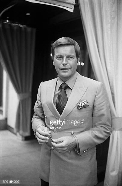 Robert Wagner holding a room key wearing a double breasted jacket at the Regency Hotel circa 1970 New York