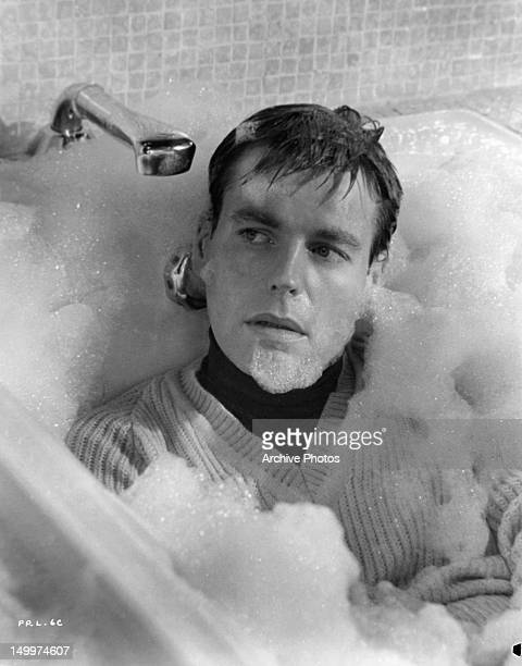 Robert Wagner in bubble bath with his clothes on in a scene from the film 'The Pink Panther', 1963.