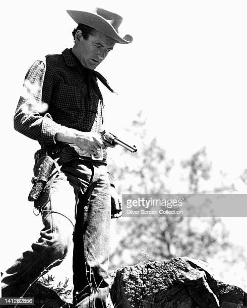Robert Walker , US actor, in Western costume and holding a pistol in a publicity still issued for the film, 'Vengeance Valley', 1958. The Western,...