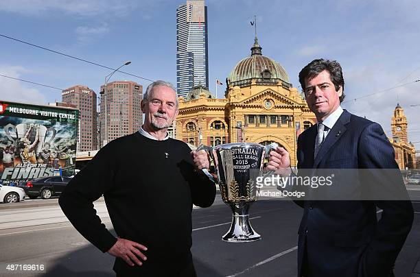 Robert Walls former premiership coach for the Carlton Blues and AFL CEO Gillon McLachlan pose with the AFL Premiership Cup in front of the iconic...