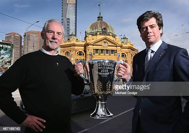 Robert Walls, former premiership coach for the Carlton Blues, and AFL CEO Gillon McLachlan pose with the AFL Premiership Cup in front of the iconic...