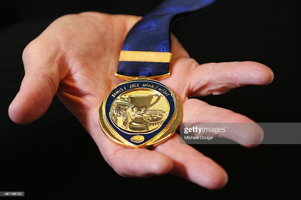 Robert Walls, former premiership coach for the Carlton Blues, holds the Jock McHale Medal during the 2015 AFL Finals Series launch at Federation Square on September 7, 2015 in Melbourne, Australia.